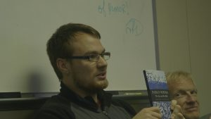 Fredrik Ryden (holding Neruda poetry book) and ThompsonCaptain Russ Devaney, VISIONS '13, Leg 3 Poetry Night