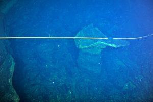 Cable draped on pillar at Axial Seamount on leg 3, Visions 13.  Photo credit: NSF-OOI/UW/CSSF