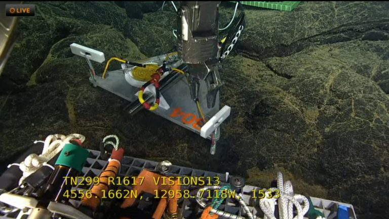 Deployment of short-period seismometers on the seafloor requires special consideration in terms of the sensors being level. Here, a special platform hosting the seismometer is being leveled by ROPOS through turning of adjustment bolts on the legs. These instruments will provide important real-time data on seismic activity inside the volcano, and associated with microfracturing events around the plumbing system for hydrothermal vents. VISIONS 13, Dive 1617  	Photo credit: NSF-OOI/UW/CSSF