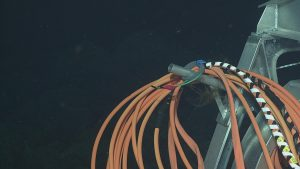 Flattened oil-filled hose on the horn of the ROV ROPOS Remotely Operated Cable Laying System (ROCLS), VISIONS '13 Dive 1610  Photo credit: OOI-NSF/UW/CSSF
