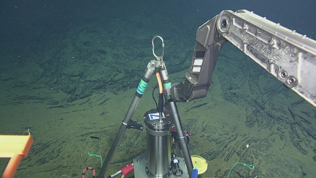 The bottom pressure and tilt instrument (BOPT), designed by Bill Chadwick of Oregon State University, being deployed onto the seafloor at Axial Volcano by ROPOS as part of the VISIONS '13 expedition.  Photo credit: OOI-NSF/UW/CSSF