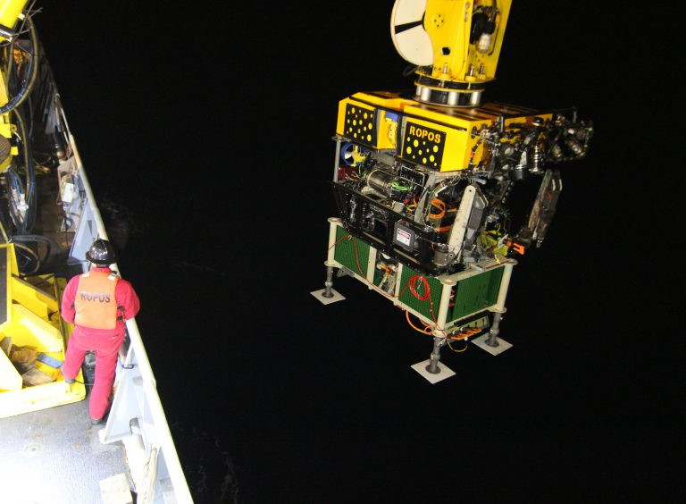 Vincent Auger of ROPOS watches over the ROV and secondary node as they are deployed over the base of Axial Seamount in preparation for deploying ~500 meters of extension cable. Photo by Allison Fundis