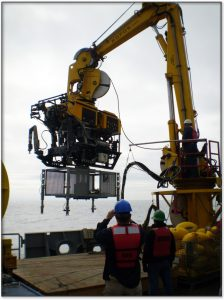 """Some of the special capabilities of ROPOS are that it can lift up to 4,000 lbs and directly couple to Junction Boxes for deployment to the seafloor, such as the one shown here. This was a test deployment of a Junction Box """"shell"""", not yet fully outfitted with electronics, cables and sensors conducted in 2011."""