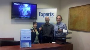 "Members of the Caris team in Alexandra, Va toast to VISIONS'11: ""TO you as you used our newly installed HIPS software for data evaluation over Axial."""