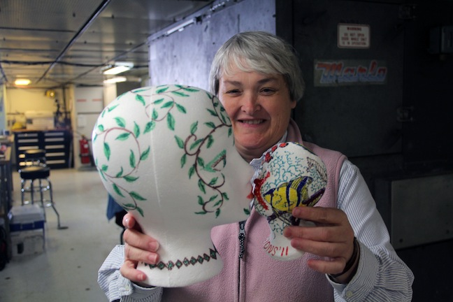 Co-chief Scientist Debbie Kelley shows the difference between a normal sized Styrofoam head with one that was shrunken by sending it to ~1000 meters water depth. (photo by Allison Fundis)