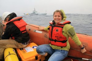 Tina Haskins of Rutgers University prepares to deploy the Slocum Glider that will survey the perimeter of Axial Seamount for the duration of Leg 2. (photo by Allison Fundis)