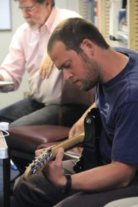 Chris Holm plays an Eddie Vedder song during Bosun's poetry night. (photo by Allison Fundis)