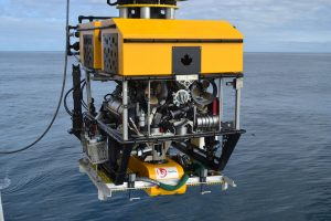 The ROV ROPOS being lowered with the BFRA (bottom frame recovery assembly) during the L3 primary node equipment-ROPOS interface tests. (photo by Mitch Elend)