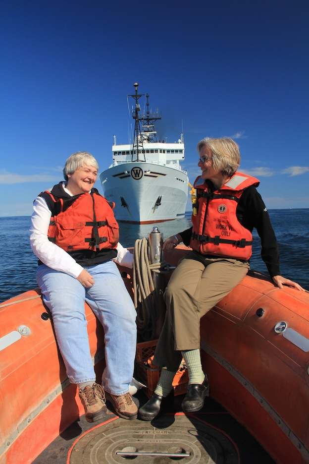 Lisa Graumlich, Dean of UW's College of the Environment, and Debbie Kelley, Co-Chief Scientist, with the R/V Thompson. (photo by Allison Fundis)