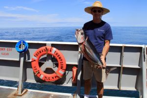 The R/V Thompson Captain, John Wilson, with his tuna.  	Captain:1  Pete:0  	(photo by Allison Fundis)