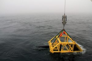 The bottom interface assembly (BIA) is lowered off the A-frame. After the BIA reached the seafloor, the science interface assembly (SIA) was coupled to ROPOS and manuevered into the BIA. (photo by Allison Fundis)