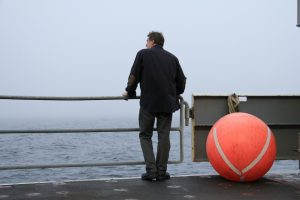 Chief Scientist, John Delaney, looks out over the morning fog just off of Whidbey Island, WA. (photo by Allison Fundis)