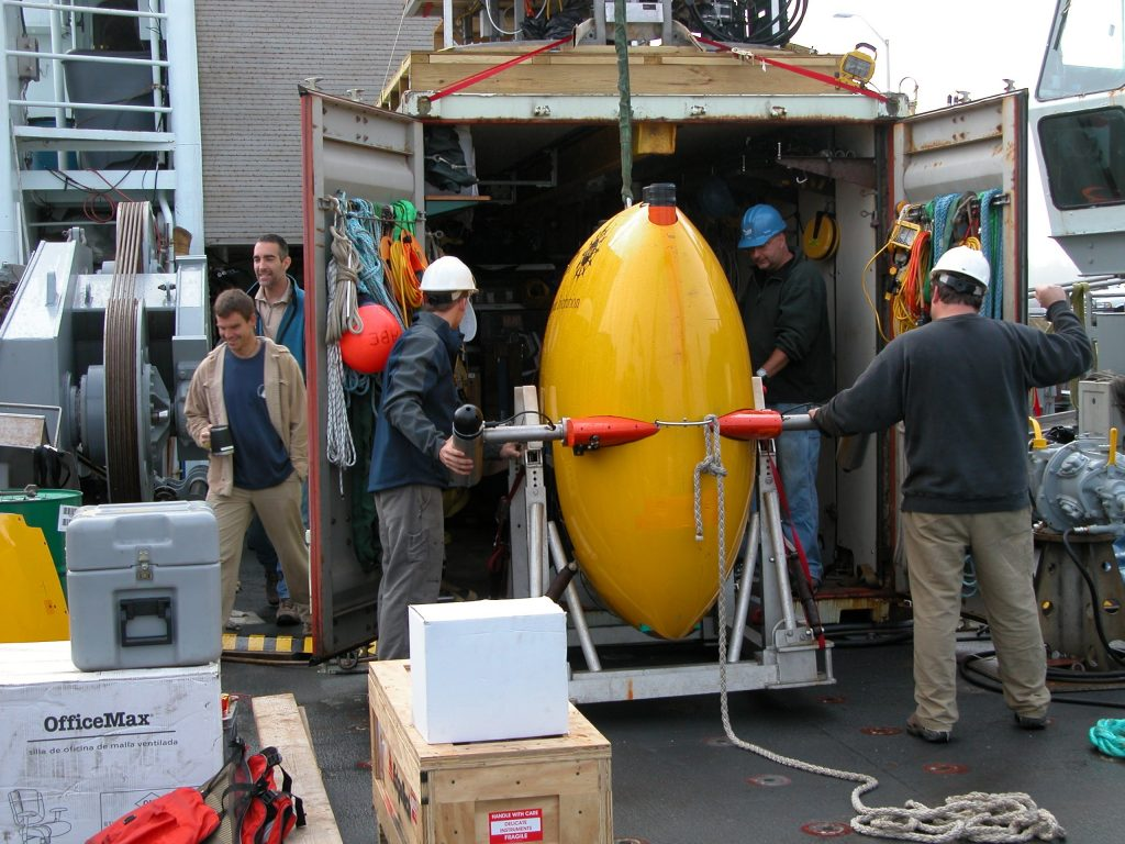 Sentry gets loaded gently into its container van for safe shipping back to Woods Hole Oceanographic Institution in Cape Cod.