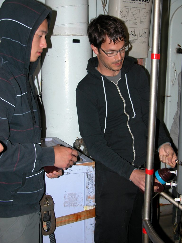 Professor Evan Solomon helps Likhi Ondov with water sampling during the first CTD station.
