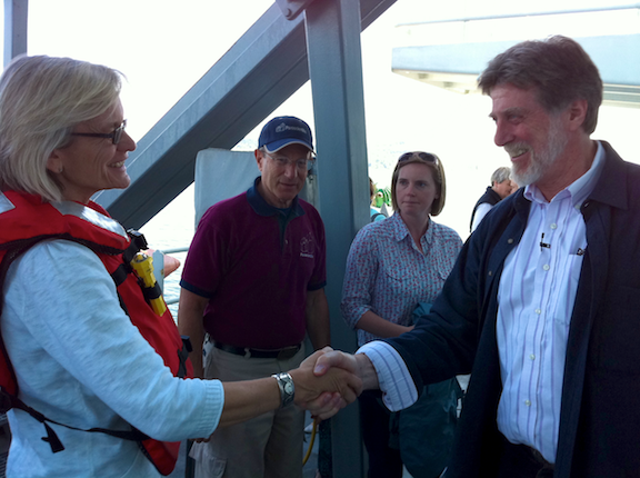 John Delaney (right) welcomes Lisa Graumlich, Dean of the University of Washington College of the Environment, aboard the R/V Thompson while the vessel is offshore Shilshole in Seattle. Center left: Jerry Paros, President of Paroscientific Inc; center right: Cara Mathison, UW College of the Environment. Photo by Ed McNichol.