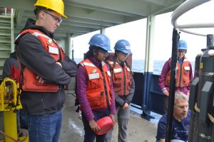Stephen and Ramya are mentored in CTD sampling. Credit: M. Elend, University of Washington.