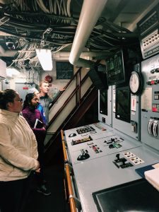VISIONS19 students looking at control panels in engine room. Credit: M. Elend, University of Washington, V19