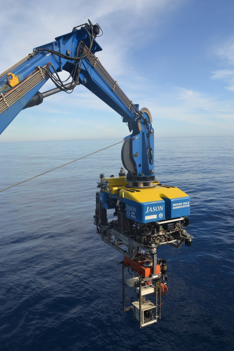 An instrumented platform to be installed on the Shallow Profiler at Axial Base is lowered under Jason on Dive J2-1151. Credit: M. Elend, University of Washington; V19.