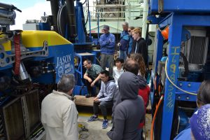 Jacob Clairmont (center) listening intently to the Jason ROV walkthrough for new Leg 3 personnel. Credit: M. Elend, University of Washington, V19