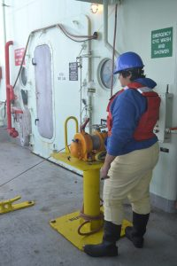 On deck recovering the CTD rosette. Credit: M. Elend, University of Washington;V19