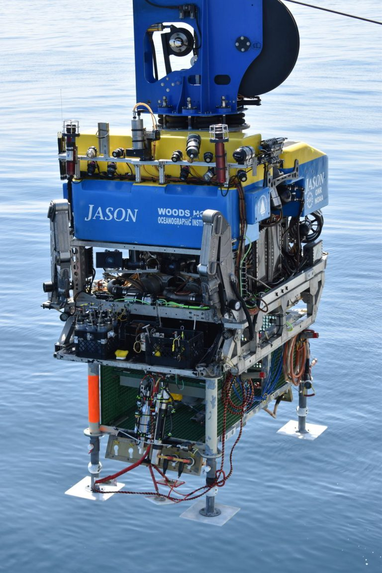 A junction box is take to the seafloor, latched beneath Jason. Credit: M. ELend, University of Washington. V20