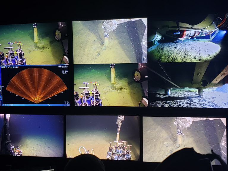 Numerous screens inside the Jason control van provide a wealth of data to the ROV and science-engineering team, here working at Slope Base taking sediment push cores. Credit. K. Gonzalez, University of Washington.