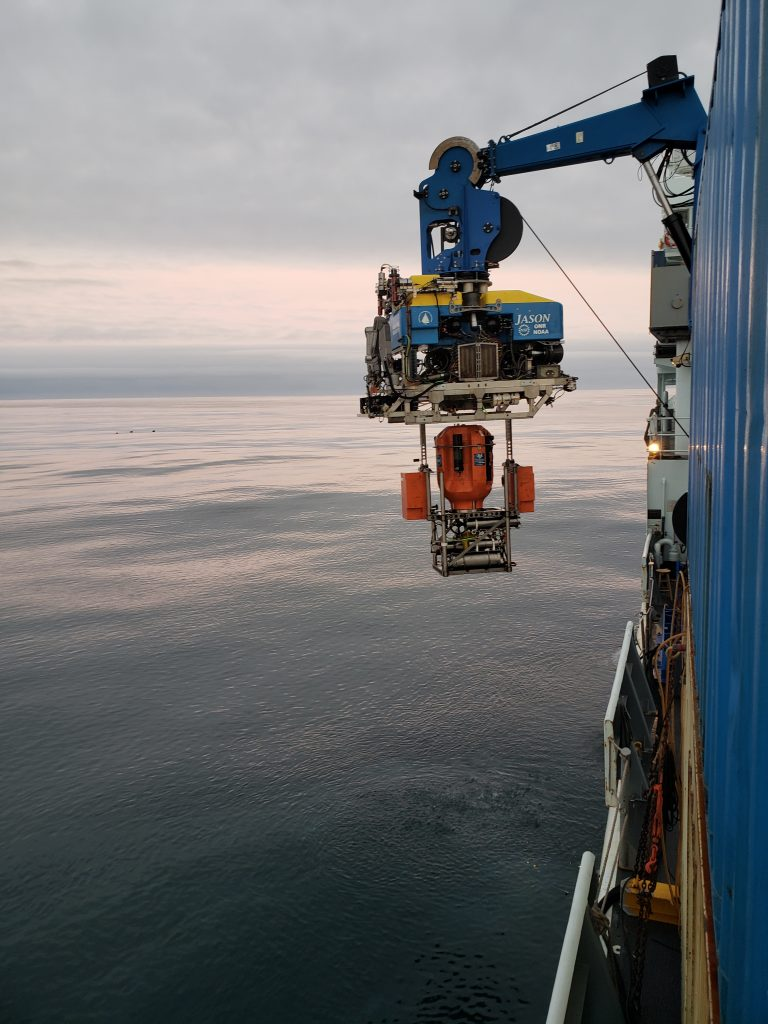 Under calm seas, Jason is latched into an winched shallow profiler platform onboard the R/V Thompson. Credit: K. Gonzalez, University of Washington