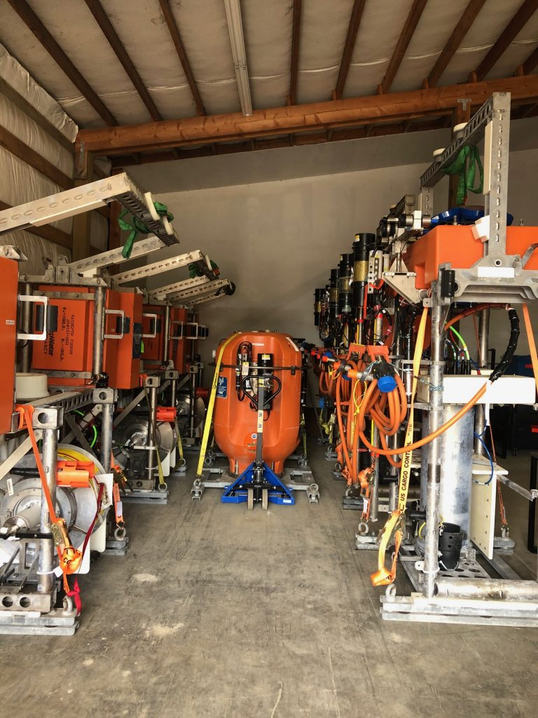 An army of instrumented stationary platforms (right) and  winched shallow profilers (left) stand guard at Newport, awaiting final integration testing. Credit: D. Manalang, University of Washington. V20