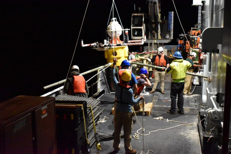 A HPIES instrument is about to go over the side of the R/V Thompson for installation at the base of Axial Seamount. Credit: University of Washington, V20.