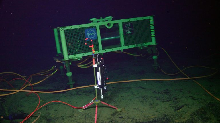 A NSF-funded CTD is reinstalled in the ASHES vent field as part of an award to Dr. Bill Chadwick (OSU). Credit: UW/NSF-OOI/OSU/WHOI. V20.