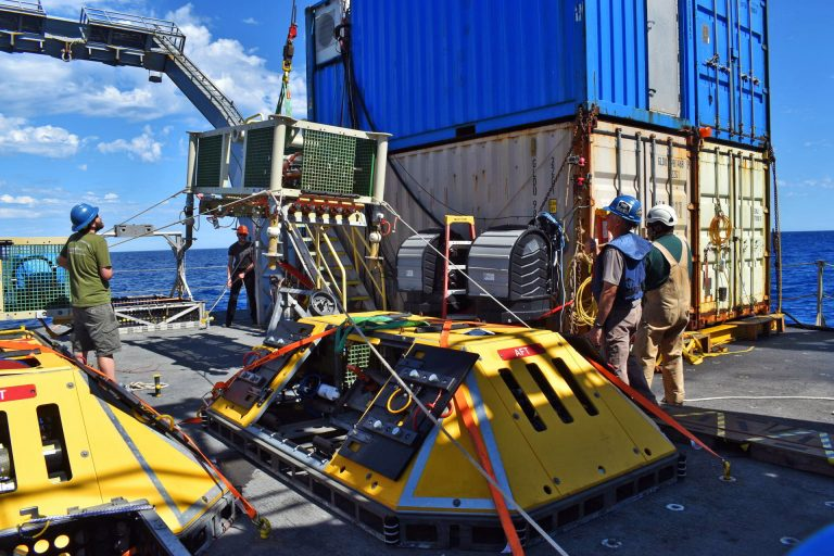 The medium powered junction box MJ03E is moved into position for latching into with Jason. Credit: UW/NSF-OOI/WHOI:V20.