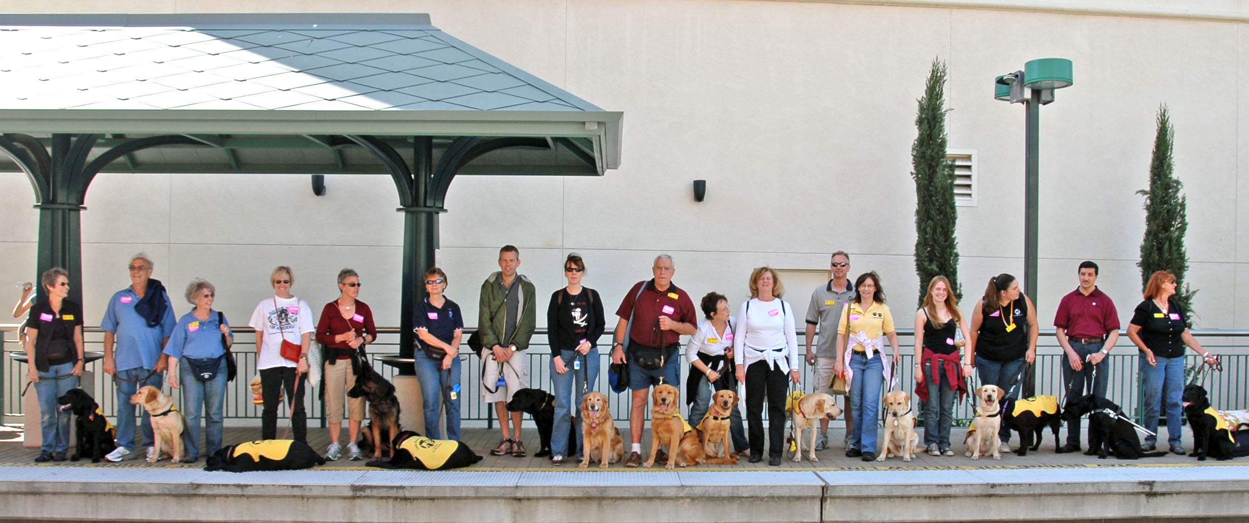 Moreno and Shadow lead tour of Metro Rail for Guide Dog puppies in training outing.
