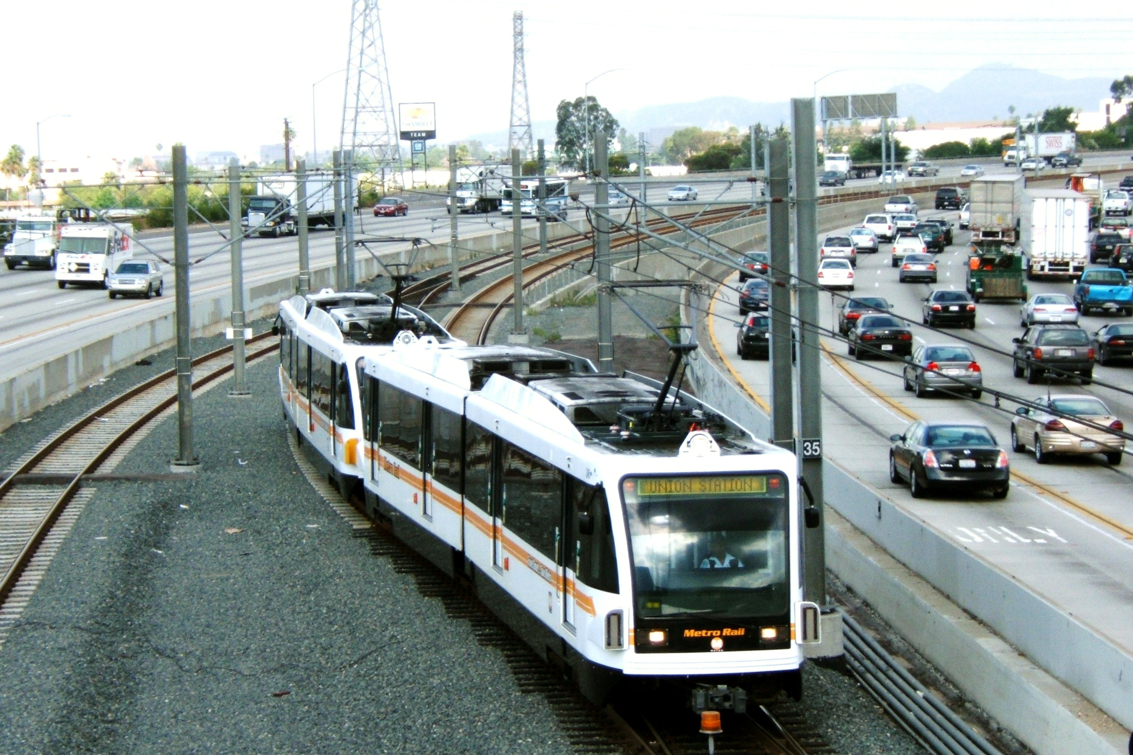 The Gold Line and the 210 Freeway by Zudi Susanto via Flickr/Creative Commons