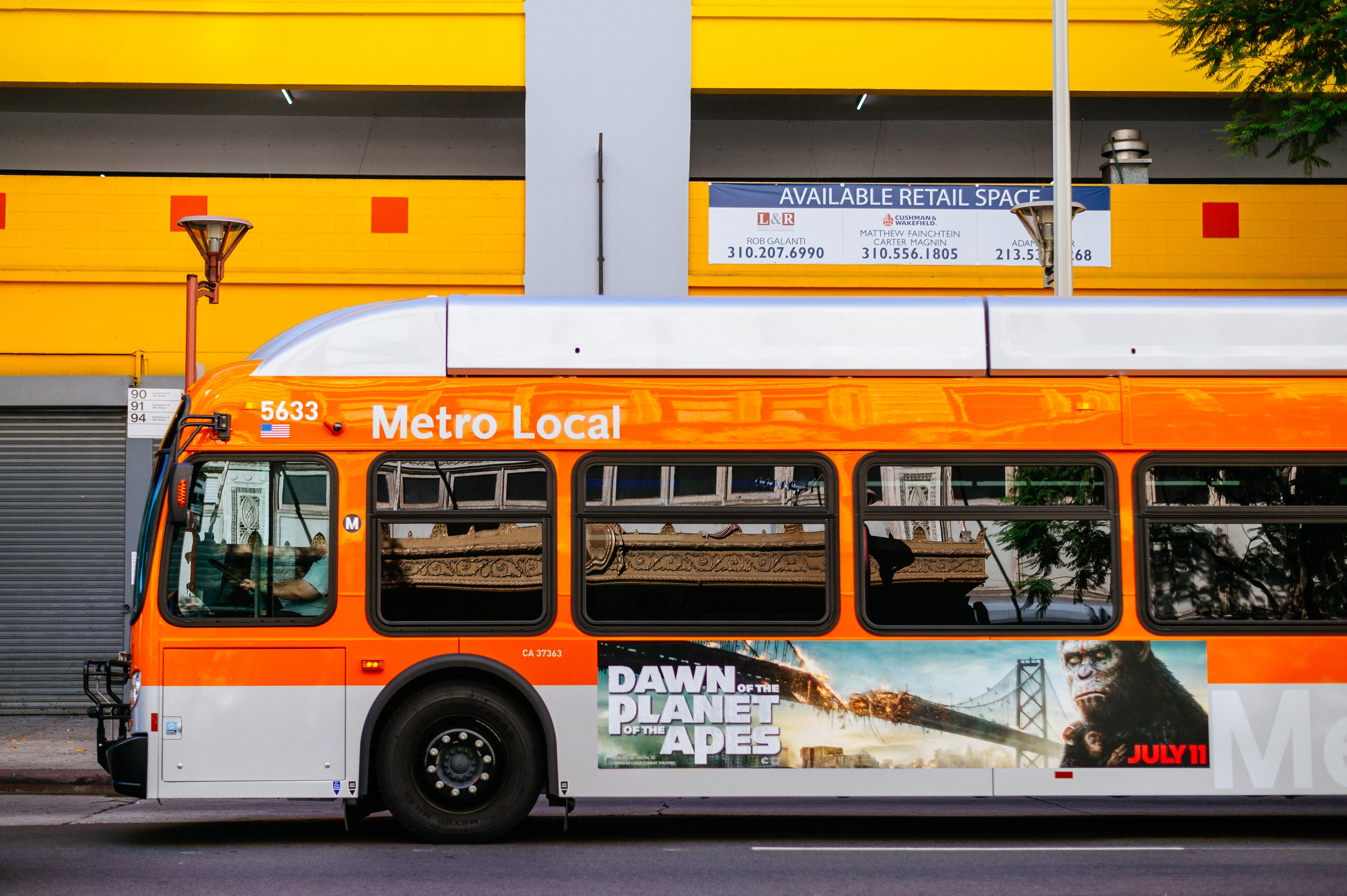 ART OF TRANSIT: Nice colors in DTLA. As for the movie ad, I know who I'm rooting for. #ApesTogetherStrong