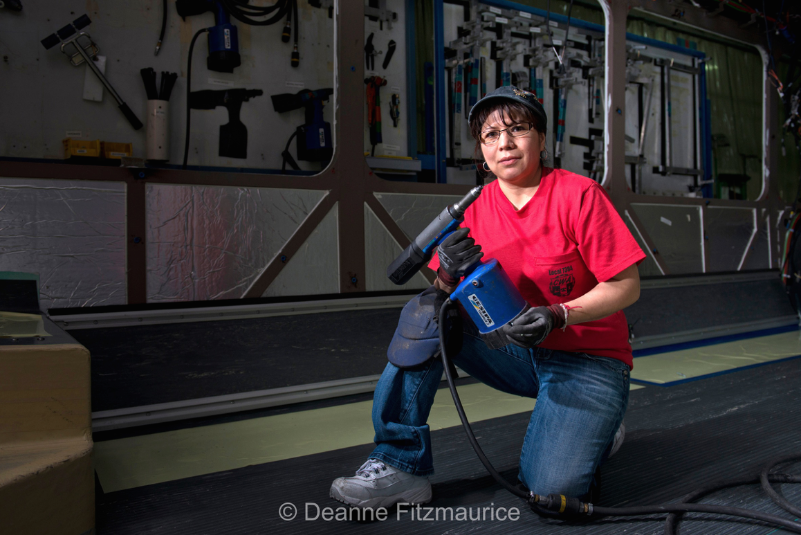Maria Nunes-Rothstein, an assembly technician at the New Flyer Industries bus factory in St. Cloud, MN.