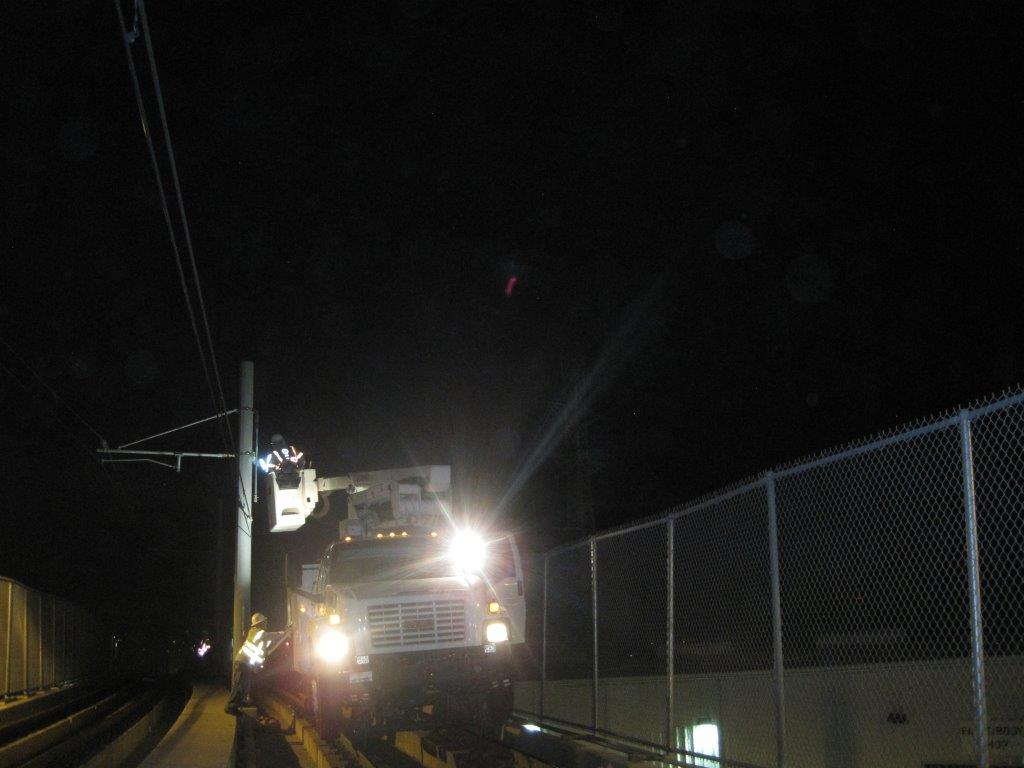 Work last night on repairing the overhead wires on the Gold Line bridge over the L.A. River. Photo: Metro.