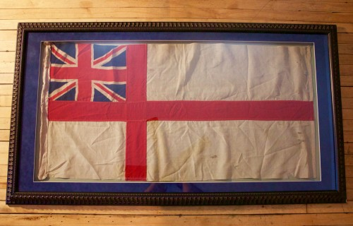 "A WWII Era Used British Naval Ensign Flag. Expertly Framed. 65"" x 36""."