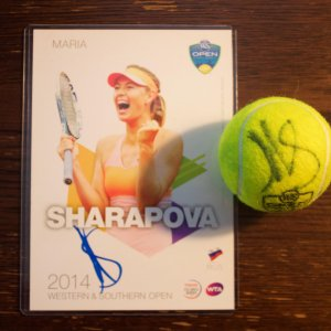 A Maria Sharapova Game-Used & Signed Match Ball.  2014 WTA Western & Southern Open.  Includes Signed Tournament Postcard.