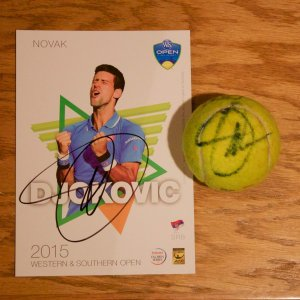 A Novak Djokovic Game-Used & Signed Tennis Match Ball.  2015 ATP Western & Southern Open.  Includes Signed Official Tournament Postcard.
