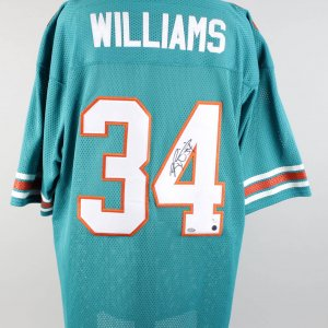 Ricky Williams Dolphins Signed & Inscribed ( 54 ) Home Jersey Photo Of Signing