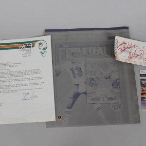 Miami Dolphins Lot - Dan Marino Signed Plane Ticket (JSA COA), Joe Robbie Signed Letter & Beckett Printing Plate Feat. Dan Marino