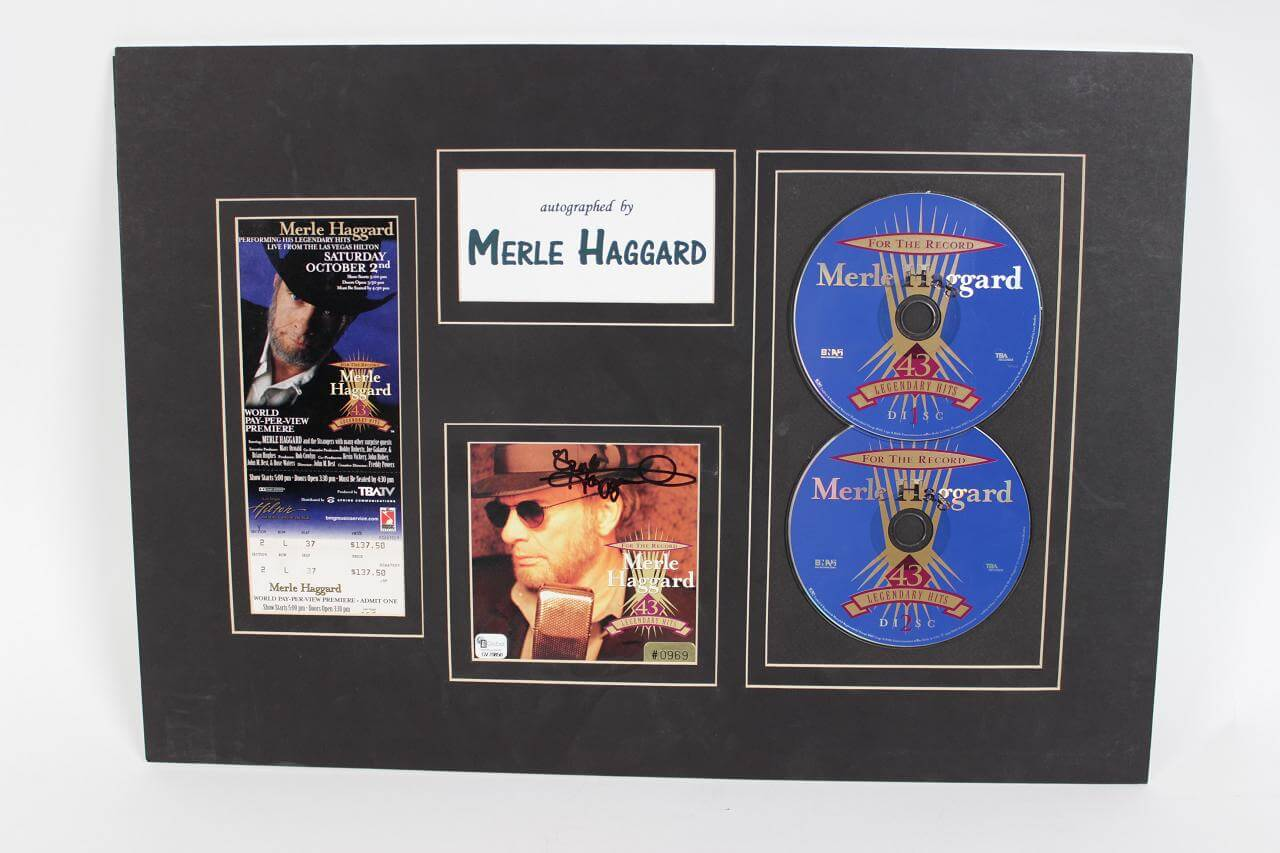 "Merle Haggard Signed CD Cover ""43d Legendary Hits"" Matted (GAI COA)"