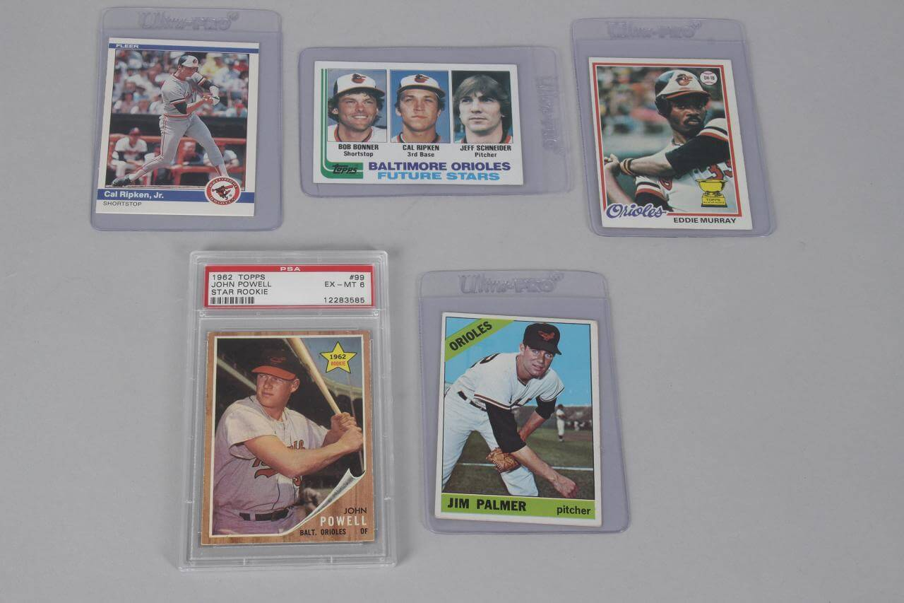 Baltimore Orioles HOFer Card Lot - 5 Incl. Cal Ripken, Jr. '84 & '82 RC +Rookies of '66 Jim Palmer, '78 Eddie Murray  & John Powell PSA Graded EX-MT 6