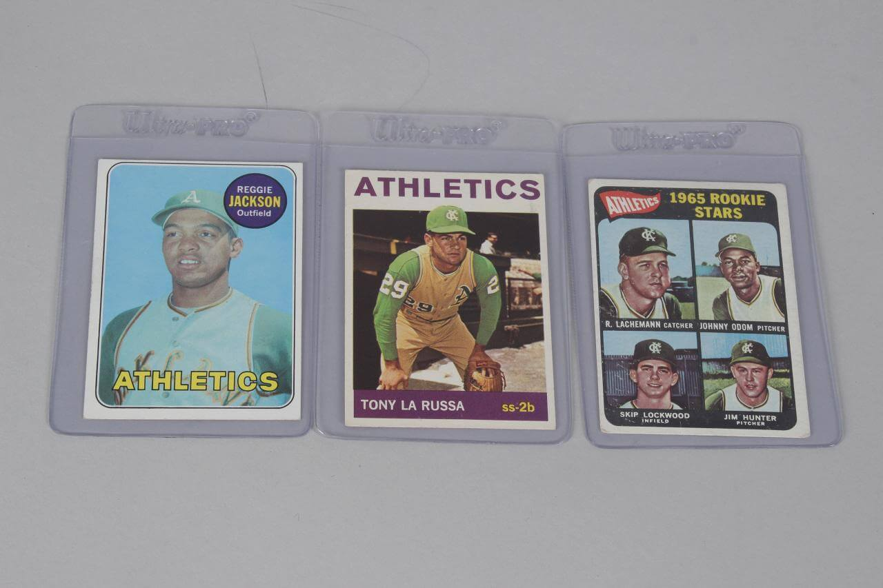 3 Oakland Athletics HOFer Topps RC Cards - '65 Catfish Hunter, '69 Reggie Jackson & LaRussa
