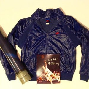 A John McEnroe Game-Used Nike Jacket.  Includes Signed Photograph & Promotional Poster.