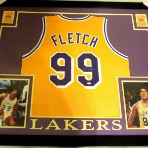 "CHEVY CHASE AUTHENTIC AUTOGRAPHED FRAMED AND MATTED ""FLETCH"" LAKERS JERSEY"