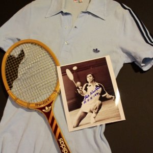 An Ilie Nastase Game-Used Custom Adidas Tennis Racquet, Shirt and Signed Photograph.