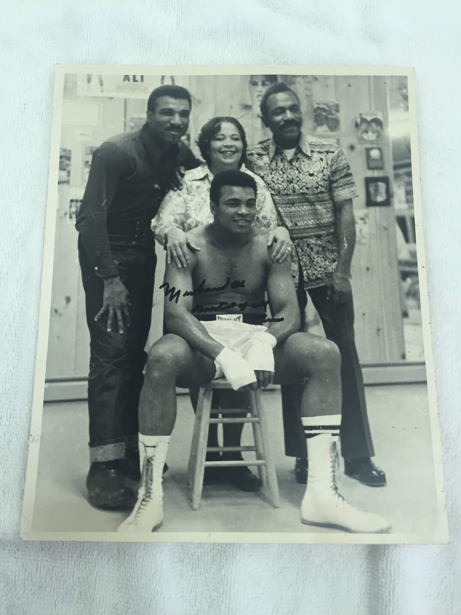 Muhammad Ali Signed and Inscribed Vintage 8x10 Wire Photo Sitting with Family