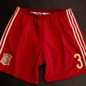 A Pair of Gerard Pique Game-Used #3 Spain International Home Shorts.  2014 FIFA World Cup.