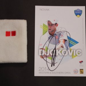 A Novak Djokovic Game-Used UNIQLO Wristband & Signed Card.  2014 ATP Western & Southern Open.